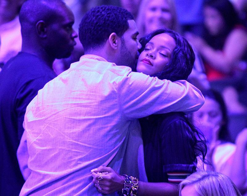 <p>The lovebirds were still going strong when they took their love back to the States and were photographed hugging at a Clippers game in L.A. (Photo: Splash News) </p>