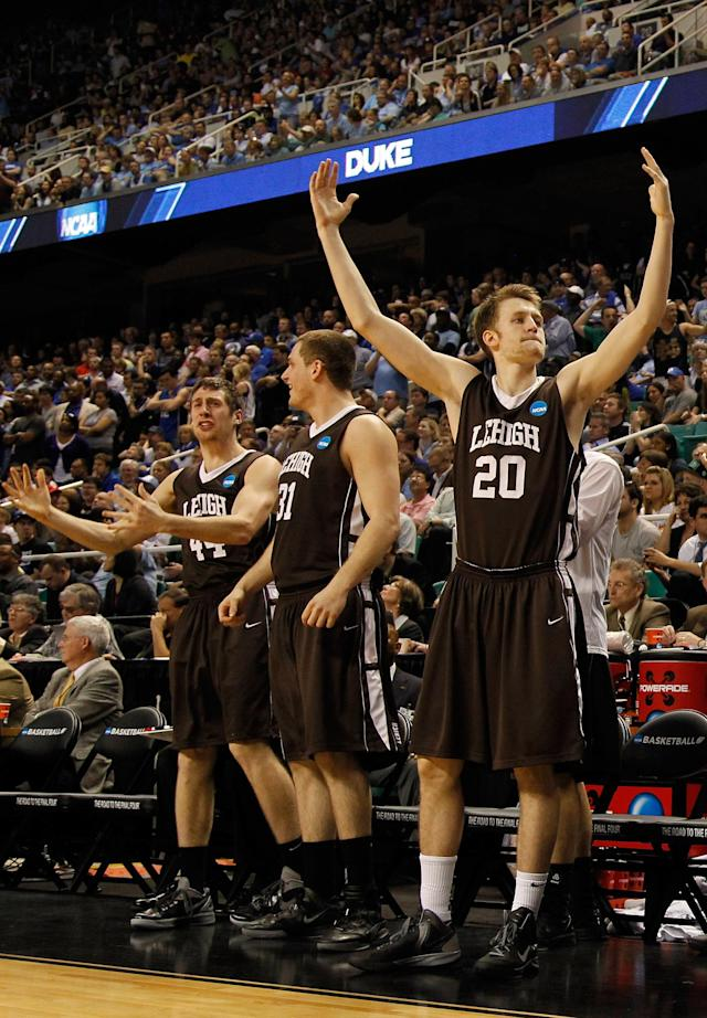 GREENSBORO, NC - MARCH 16: (R-L) Holden Greiner #20, Justin Maneri #31 and Jordan Hamilton #44 of the Lehigh Mountain Hawks celebrate late in the second half before the Mountain Hawks defeat the Duke Blue Devils during the second round of the 2012 NCAA Men's Basketball Tournament at Greensboro Coliseum on March 16, 2012 in Greensboro, North Carolina. (Photo by Mike Ehrmann/Getty Images)