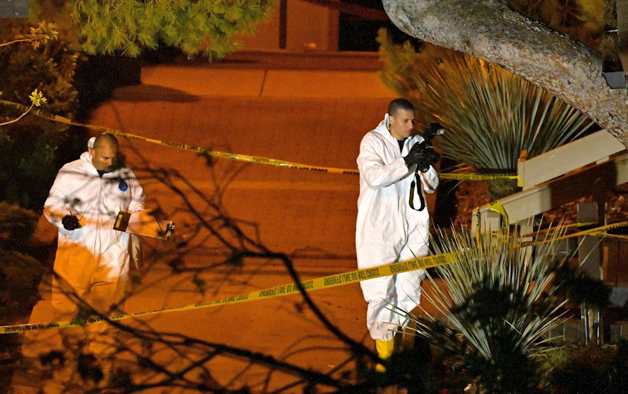 A forensics team works the scene on Thursday in Thousand Oaks.