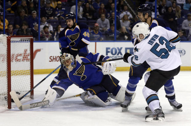 San Jose Sharks' Matt Irwin (52) scores past St. Louis Blues goalie Jaroslav Halak, of Slovakia, as Blues' Roman Polak (46), of the Czech Republic, and Chris Stewart watch during the first period of an NHL hockey game Tuesday, Dec. 17, 2013, in St. Louis. (AP Photo/Jeff Roberson)