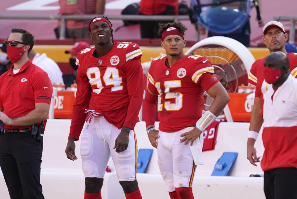 Kansas City Chiefs defensive end Taco Charlton (94) and quarterback Patrick Mahomes (15) watch from the bench during the second half of an NFL football game against the Las Vegas Raiders, Sunday, Oct. 11, 2020, in Kansas City. The Raiders won 40-32. (AP Photo/Charlie Riedel)