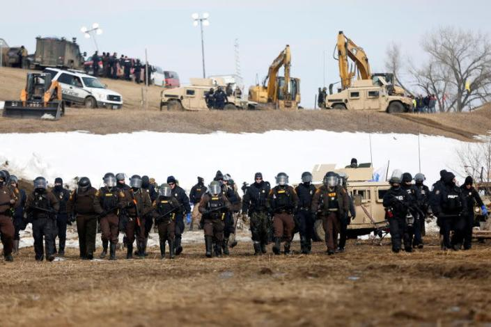 FILE PHOTO: Law enforcement officers advance into the main opposition camp against the Dakota Access oil pipeline near Cannon Ball