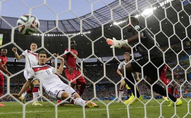 Germany's Miroslav Klose, center, scores his side's second goal during the group G World Cup soccer match between Germany and Ghana at the Arena Castelao in Fortaleza, Brazil, Saturday, June 21, 2014. (AP Photo/Frank Augstein)