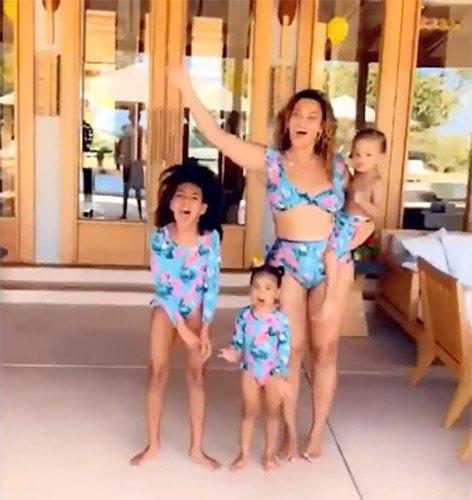 """Twinning with the twins! In a <a href=""""https://www.instagram.com/p/B6xOswdHe9a/"""">video</a> Bey posted recapping the <a href=""""https://people.com/parents/beyonce-new-photos-kids-end-of-year-recap-video/"""">highlights of her momentous 2019</a>, Beyoncé and Blue coordinated in blue bathing suits with pink-and-green flowers to match 2½-year-old twins Rumi and Sir."""