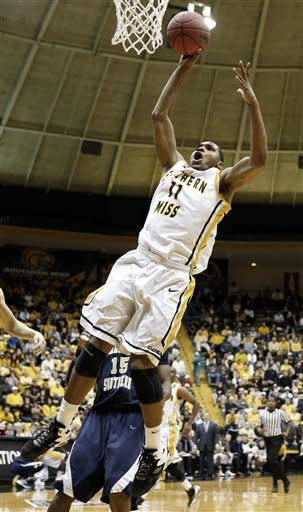 Southern Mississippi forward Daveon Boardingham (11) attempts a dunk past Charleston Southern forward Paul Gombwer (15) in the first half of their NIT college basketball game in Hattiesburg, Miss., Wednesday, March 20, 2013. The dunk-attempt failed. (AP Photo/Rogelio V. Solis)