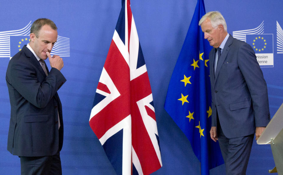 FILE - In this Friday, Aug. 31, 2018 file photo Britain's Secretary of State for Exiting the European Union Dominic Raab, left, and EU chief Brexit negotiator Michel Barnier at EU headquarters in Brussels. He's known throughout most of Europe as Mr. Brexit, but not so well known at home in France. With a new book out this week, and interviews in national media, Michel Barnier is trying to raise his profile ahead of next April's presidential election. (AP Photo/Virginia Mayo, File)