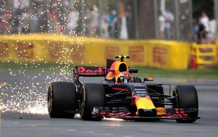 Formula One - F1 - Australian Grand Prix - Melbourne, Australia - 24/03/2017 Red Bull Racing driver Max Verstappen of the Netherlands showers sparks on the track during the first practice session. REUTERS/Jason Reed