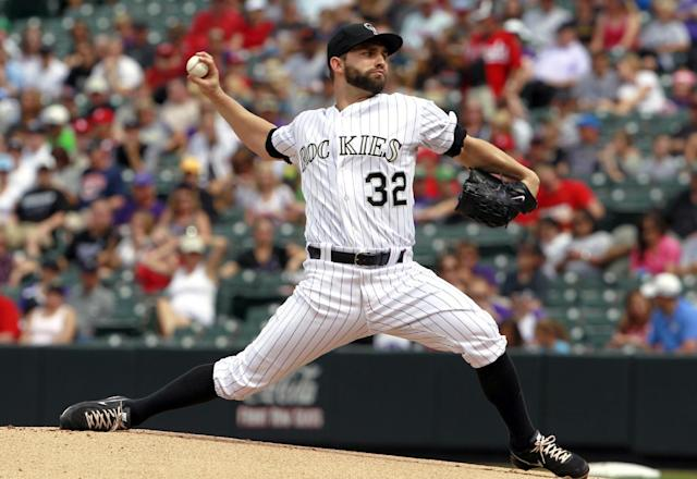 Colorado Rockies starting pitcher Tyler Chatwood works against the Cincinnati Reds in the first inning of a baseball game in Denver on Sunday, Sept. 1, 2013. (AP Photo/David Zalubowski)