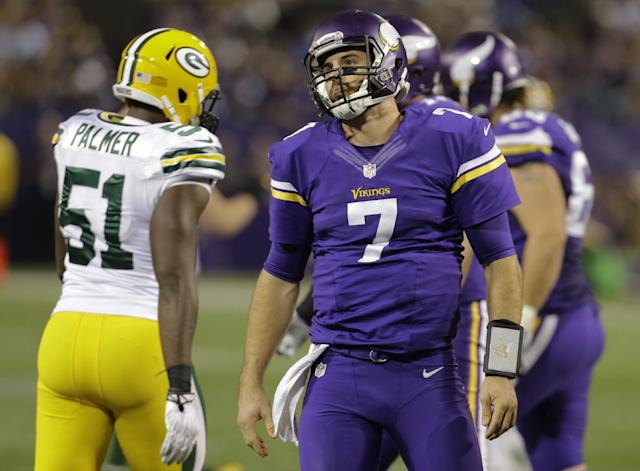 Minnesota Vikings quarterback Christian Ponder (7) gets up after being sacked by Green Bay Packers defensive end Mike Daniels (76) in the second half of an NFL football game, Sunday, Oct. 27, 2013, in Minneapolis. (AP Photo/Ann Heisenfelt)