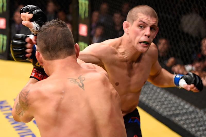 LAS VEGAS, NV - JULY 09: (R-L) Joe Lauzon punches Diego Sanchez in their lightweight bout during the UFC 200 event on July 9, 2016 at T-Mobile Arena in Las Vegas, Nevada. (Photo by Josh Hedges/Zuffa LLC/Zuffa LLC via Getty Images)