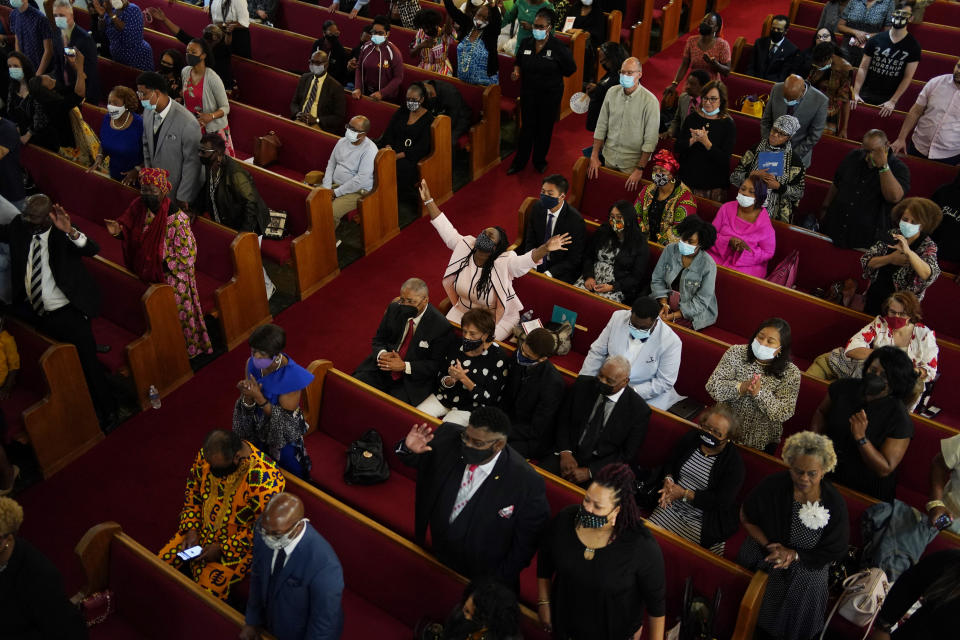 People attend a joint service for the centennial of the Tulsa Race Massacre at First Baptist Church of North Tulsa, Sunday, May 30, 2021, in Tulsa, Okla. (AP Photo/John Locher)