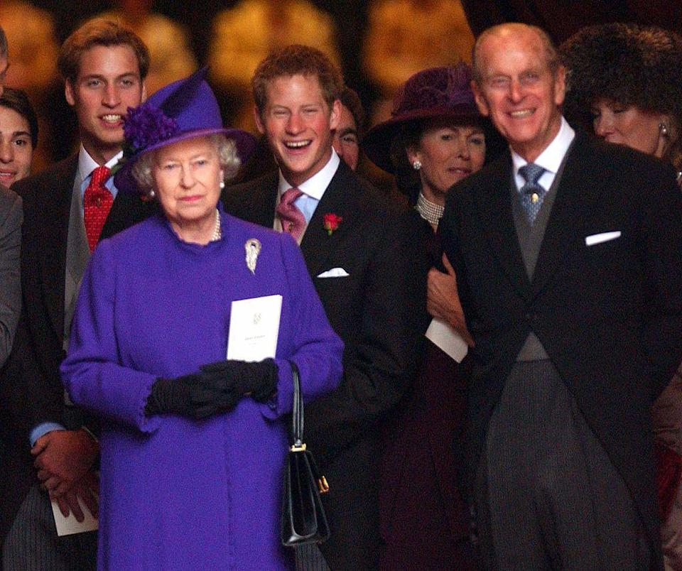 <p>At a wedding, with grandsons Prince William and Prince Harry behind them, at Chester Cathedral.</p>