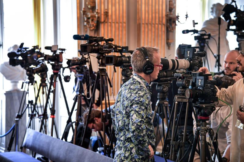 Journalists prepare themselves ahead of the announcement of the winners of the Nobel Prize in Literature 2019, in Stockholm, Sweden, Thursday Oct. 10, 2019. Two Nobel Prizes in literature will be announced Thursday after the 2018 literature award was postponed following sex abuse allegations that rocked the Swedish Academy a year ago. (Anders Wiklund / TT via AP)
