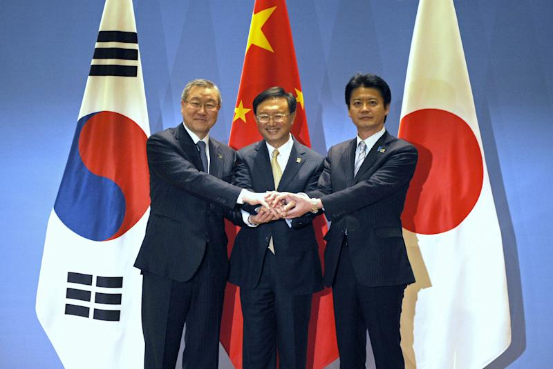 China's Foreign Minister Yang Jiechi, center, Japanese Foreign Minister Koichiro Gemba, right, and South Korean Foreign Minister Kim Sung-hwan pose for a photo before the start of the 6th Trilateral Foreign Ministers Meeting between China, Japan and South Korea in the eastern Chinese city of Ningbo on Sunday, April 8, 2012. (AP Photo/Peter Parks, Pool)