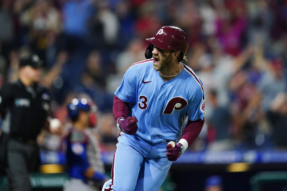 Philadelphia Phillies' Bryce Harper reacts after hitting a three-run home run against Chicago Cubs pitcher Rex Brothers during the seventh inning of a baseball game, Thursday, Sept. 16, 2021, in Philadelphia. (AP Photo/Matt Slocum)
