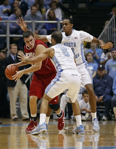 North Carolina's Kendall Marshall (5) and John Henson pressure Nicholls State's Lachlan Prest, left, during the first half of an NCAA college basketball game in Chapel Hill, N.C., Monday, Dec. 19, 2011. (AP Photo/Gerry Broome)