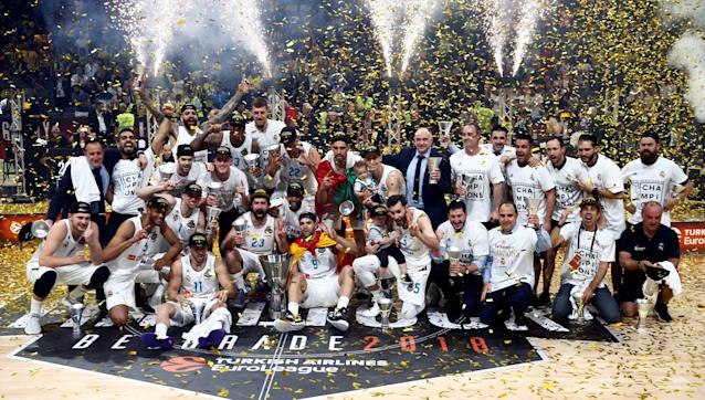 Basketball - Euroleague Final Four Final - Real Madrid vs Fenerbahce Dogus Istanbul - Stark Arena, Belgrade, Serbia - May 20, 2018 Real Madrid players celebrate winning the final with the trophy REUTERS/Alkis Konstantinidis