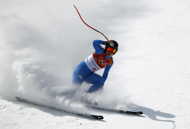 <p>Italy's Sofia Goggia comes to a stop after competing in the women's downhill at the 2018 Winter Olympics in Jeongseon, South Korea, Wednesday, Feb. 21, 2018. (AP Photo/Charlie Riedel) </p>