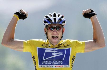 FILE PHOTO: U.S. Postal Service Team rider Lance Armstrong of the United States raises his arms as he crosses the finish line to win the 204.5 km long 17th stage of the Tour de France from Bourd-d'Oisans to Le Grand Bornand, France, July 22, 2004. REUTERS/Wolfgang Rattay/File Photo