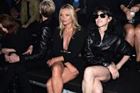 <p>The model and actress sit front row in Saint Laurent at the resort show in New York.</p>