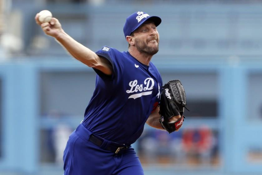 Los Angeles Dodgers starting pitcher Max Scherzer throws to a New York Mets batter during the first inning of a baseball game in Los Angeles, Saturday, Aug. 21, 2021. (AP Photo/Alex Gallardo)