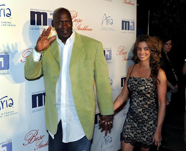 In this photo provided by the Las Vegas News Bureau, basketball great Michael Jordan and girlfriend Yvette Prieto arrive for a celebrity dinner at Beso inside Crystals in City Center in Las Vegas. Jordan's wife, Yvette, has given birth to the couple's identical twin daughters on Tuesday, Feb. 11, 2014, Jordan's spokeswoman Estee Portnoy told The Associated Press. (AP Photo/Las Vegas News Bureau, Brian Jones)