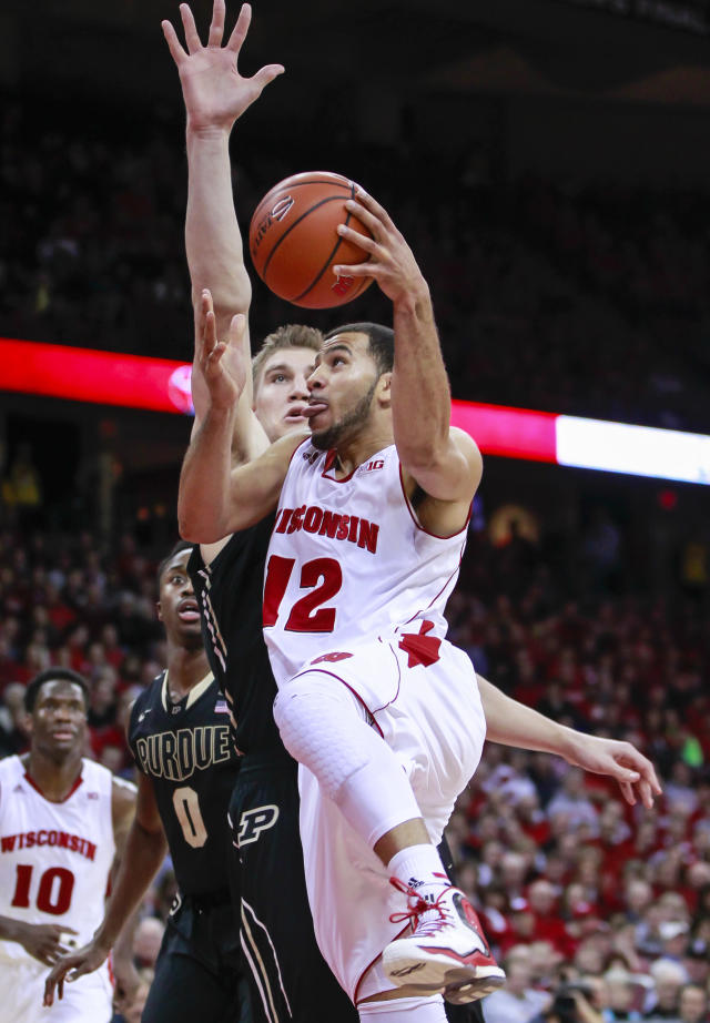 Wisconsin's Traevon Jackson (12) drives to the basket against Purdue's Isaac Haas during the second half of an NCAA college basketball game Wednesday, Jan. 7, 2015, in Madison, Wis. Wisconsin won 62-55. (AP Photo/Andy Manis)
