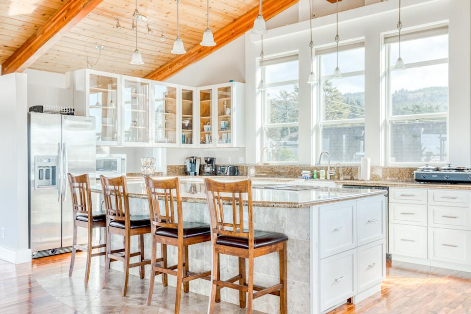 """<strong>Bedrooms:</strong> 3<br> <strong>Bathrooms:</strong> 3.5<br> <strong>Minimum stay:</strong> 3 nights<br> <br> This three-story vacation home on the Northern Oregon coast is brimming with amenities, including a sauna, hot tub, multiple fireplaces, and even an elevator. The family-friendly house is gorgeous, spacious, and a stone's throw to the shore. Make sure to stop by the Tillamook Cheese Factory (just 10 minutes away by car) and Cape Meares Lighthouse. $310, Marriott (Starting Price). <a href=""""https://homes-and-villas.marriott.com/en/properties/78120432-cape-meares-blue-ocean-beauty"""" rel=""""nofollow noopener"""" target=""""_blank"""" data-ylk=""""slk:Get it now!"""" class=""""link rapid-noclick-resp"""">Get it now!</a>"""