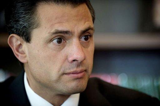 The Mexican presidential candidate for the Institutional Revolutionary Party (PRI), Enrique Pena Nieto listens to a question during a meeting with the international press in Mexico City. Pena Nieto delivered a stunning return to power for Mexico's once-reviled PRI party, but the president-elect faces a stiff challenge in cutting poverty and clamping down on rampant drug violence