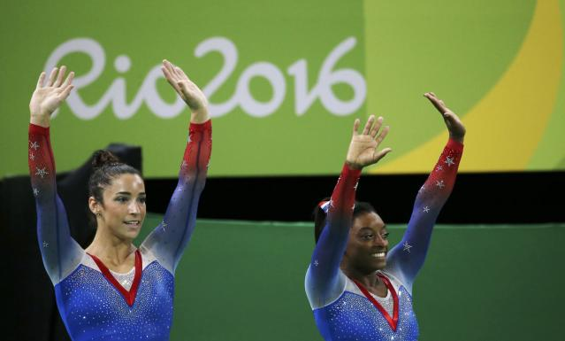 2016 Rio Olympics - Artistic Gymnastics - Final - Women's Floor Final - Rio Olympic Arena - Rio de Janeiro, Brazil - 16/08/2016. Simone Biles (USA) of USA (R) and Alexandra Raisman (USA) of USA (Aly Raisman) celebrate winning the gold and the silver respectively. REUTERS/Ruben Sprich FOR EDITORIAL USE ONLY. NOT FOR SALE FOR MARKETING OR ADVERTISING CAMPAIGNS.