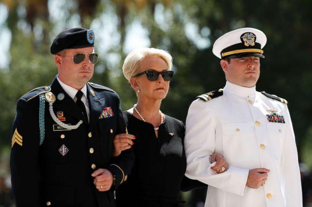 PHOTO: Cindy McCain arrives for a memorial service for Sen. John McCain, R-Ariz. at the Arizona Capitol, Aug. 29, 2018, in Phoenix, escorted by her sons Jimmy, left, and Jack. (Matt York/AP)