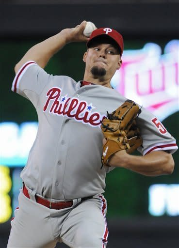 Philadelphia Phillies pitcher Joe Blanton throws to the Minnesota Twins in the first inning of a baseball game Thursday, June 14, 2012, in Minneapolis. (AP Photo/Jim Mone)