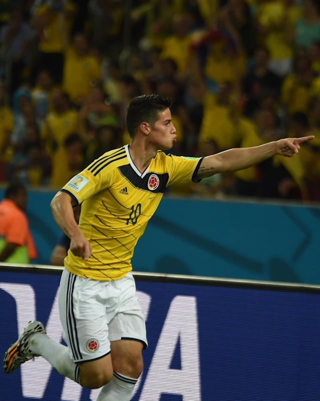 Colombia's midfielder James Rodriguez celebrates scoring the 2-0 goal during the Round of 16 football match between Colombia and Uruguay at the Maracana Stadium in Rio de Janeiro during the 2014 FIFA World Cup in Brazil on June 28, 2014 (AFP Photo/Luis Acosta )