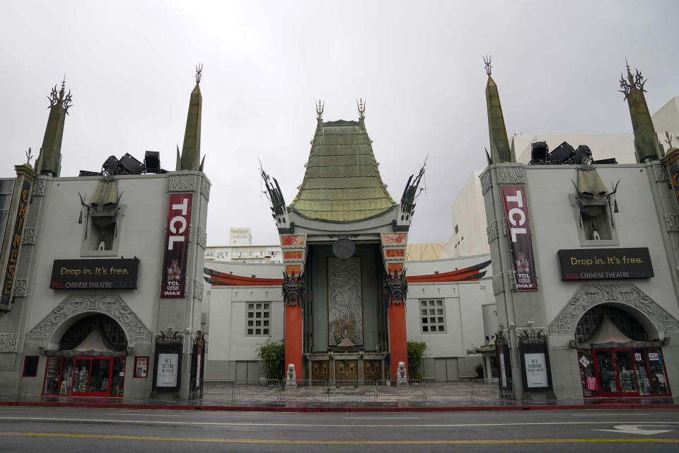 FILE - In this May 18, 2020, file photo, the TCL Chinese Theatre is shown with no people present in the Hollywood area of Los Angeles. Los Angeles County is expected to move Tuesday, May 4, 2021, into the least-restrictive yellow tier, amid the coronavirus pandemic. (AP Photo/Ashley Landis, File)