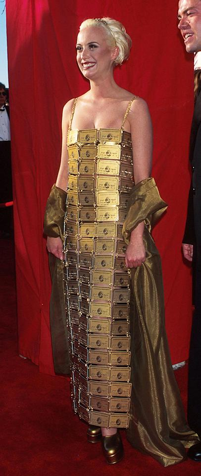 "Lizzy Gardiner, 1995. Wearing another dress that merited a Wikipedia entry , the costume designer strung together 254 American Express Gold cards. She had wanted to do this for ""The Adventures of Priscilla, Queen of the Desert,"" but AMEX nixed that costume. While her DIY credit transaction was ridiculed, the dress raised more than $12,000 for AIDS research. Oh, and she won that year for Best Costume Design for ""Priscilla."" Gardiner later said that she was too "" broke "" for a real dress. Did it have to do with owning 254 cards?"