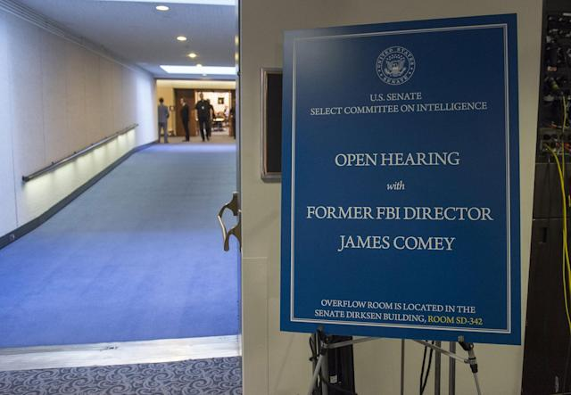 <p>A sign sits outside the entrance to the hearing room where former FBI Director James Comey will testify during a US Senate Select Committee on Intelligence hearing on Capitol Hill in Washington, June 8, 2017. (Photo: Saul Loeb LOEB/AFP/Getty Images) </p>