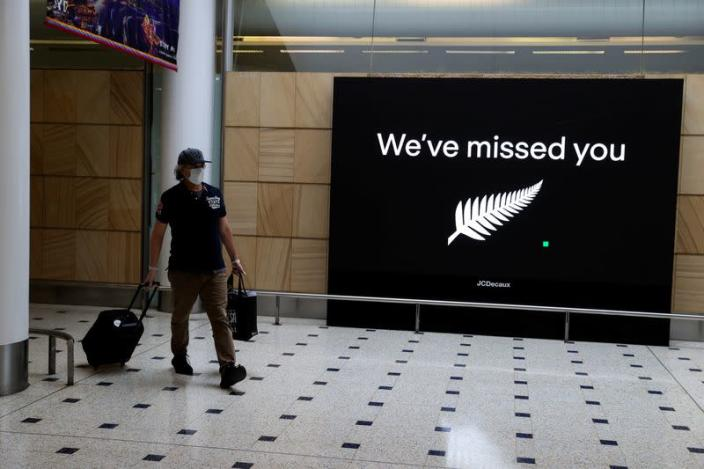 FILE PHOTO: Passengers arrive from New Zealand after the Trans-Tasman travel bubble opened overnight, at Sydney Airport