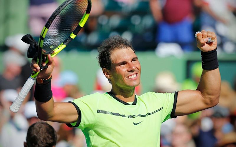 Rafael Nadal celebrates after defeating Nicolas Mahut - Credit: AP