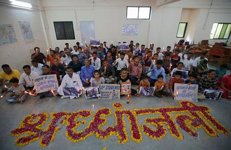 FILE PHOTO: People attend a prayer meet to pay tribute to the victims of a fire that broke out in a commercial building in the western city of Surat on Friday, inside a library in Ahmedabad, India, May 25, 2019. REUTERS/Amit Dave