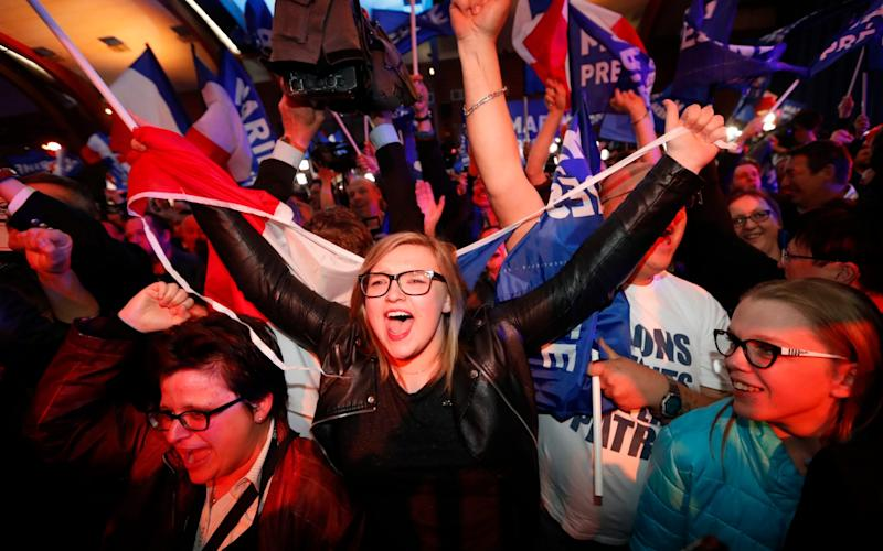 Supporters of far-right leader and candidate for the 2017 French presidential election, Marine Le Pen, celebrate - Credit: AP
