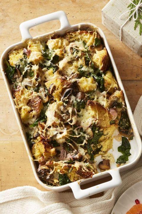 """<p>Sleep in an extra hour with this delicious make-ahead breakfast. Savory bread pudding (also called a strata) can be assembled a day in advance, then covered and refrigerated overnight before baking in the morning.</p><p><em><a href=""""https://www.goodhousekeeping.com/food-recipes/a25325018/mushroom-and-spinach-bread-pudding-recipe/"""" rel=""""nofollow noopener"""" target=""""_blank"""" data-ylk=""""slk:Get the recipe for Mushroom and Spinach Bread Pudding »"""" class=""""link rapid-noclick-resp"""">Get the recipe for Mushroom and Spinach Bread Pudding »</a></em> </p>"""