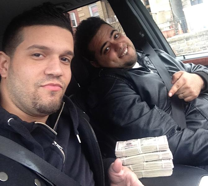 In this undated photo provided by the United States Attorney's Office for the Southern District of New York, Elvis Rafael Rodriguez, left, and Emir Yasser Yeje, pose with bundles of cash allegedly stolen using bogus magnetic swipe cards at cash machines throughout New York. Prosecutors in New York on Thursday, May 9, 2103 said that they are members of worldwide gang of criminals who stole $45 million in hours by hacking into a database of prepaid debit cards and draining cash machines around the globe. An indictment unsealed Thursday accused U.S. cell ringleader Alberto Yusi Lajud-Pena and seven other New York suspects of withdrawing $2.8 million in cash from hacked accounts in less than a day. (AP Photos/U.S. Attorney's Office for the Southern District of New York)