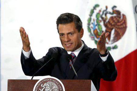 Mexico's President Enrique Pena Nieto delivers a speech during the 78th anniversary of the expropriation of Mexico's oil industry in Mexico City