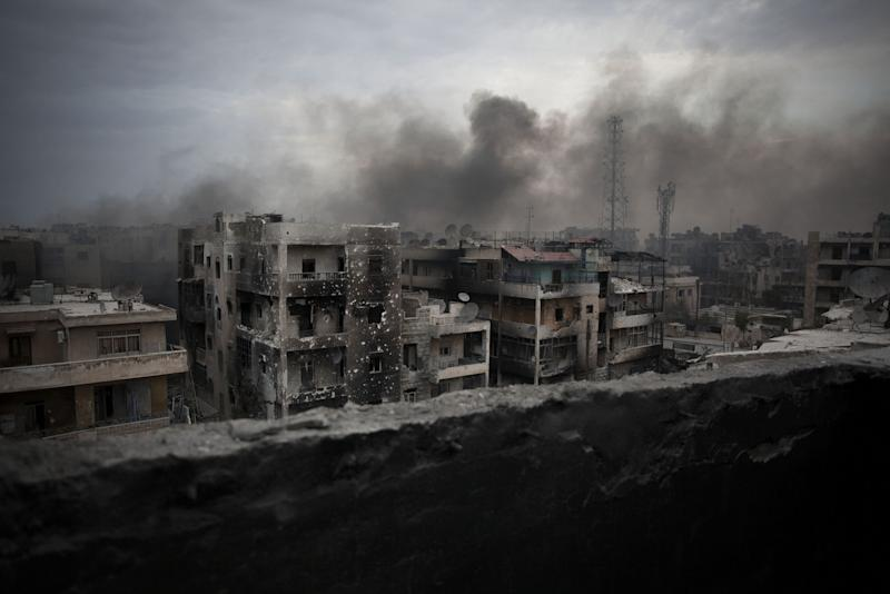 Smoke rises over the war-torn city of Aleppo (Getty Images)
