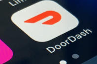 FILE - The DoorDash app is shown on a smartphone on Feb. 27, 2020, in New York. In 2020, many people took to working remotely in sweatpants, hopped onto an expensive high-tech exercise bike and had their favorite restaurant dish delivered, perhaps by a driver trying to earn an extra buck and hoping not to catch the coronavirus. (AP Photo)
