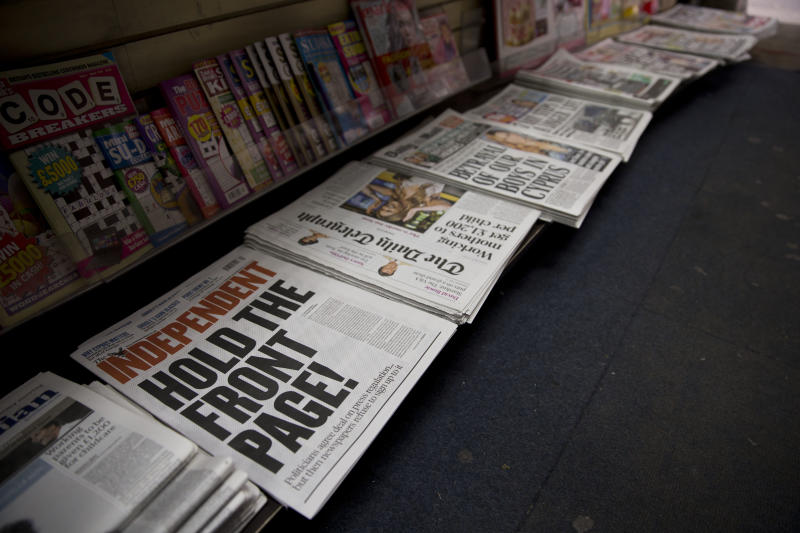 British newspapers are displayed on sale in a newsagents in London, Tuesday, March 19, 2013.  Britain's politicians have finally struck a deal to regulate their country's press. Whether the media will allow itself to be regulated is another question.  Across Britain, newspaper front pages voiced disquiet at the establishment of an independent watchdog which would have the power to order prominent apologies and take complaints into arbitration.  (AP Photo/Matt Dunham)