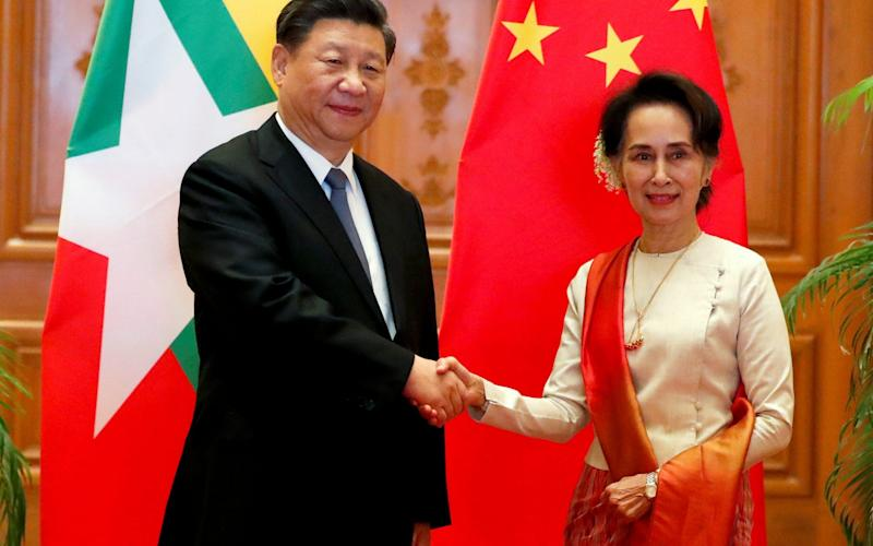 Xi Jinping is on a trade visit to Aung San Suu Kyi in Burma - REUTERS