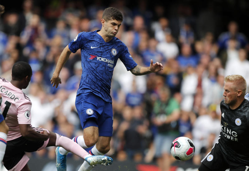 FILE - In this Sunday, Aug. 18, 2019 file photo, Chelsea's Christian Pulisic, center, vies for the ball with Leicester's Ricardo Pereira, left, in front of Leicester's goalkeeper Kasper Schmeichel, right, during the English Premier League soccer match between Chelsea and Leicester City at Stamford Bridge stadium in London. U.S. winger, Christian Pulisic, who completed his move to Stamford Bridge in the offseason for $73 million, hasn't played a minute of Chelsea's last three Premier League matches and also stayed on the bench during the team's 1-0 home loss to Valencia in the Champions League two weeks ago. (AP Photo/Frank Augstein, File)