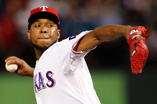 ARLINGTON, TX - OCTOBER 24: Neftali Feliz #30 of the Texas Rangers pitches in the ninth inning during Game Five of the MLB World Series against the St. Louis Cardinals at Rangers Ballpark in Arlington on October 24, 2011 in Arlington, Texas. The Rangers won 4-2. (Photo by Tom Pennington/Getty Images)