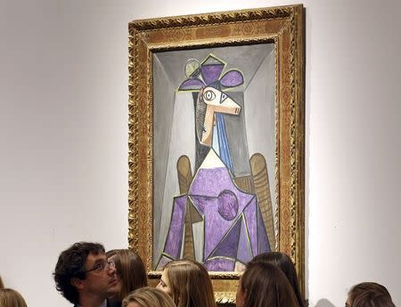 """An artwork titled """"Portrait de femme (Dora Maar)"""" by artist Pablo Picasso is seen during a Christie's auction in New York May 6, 2014. REUTERS/Adam Hunger"""